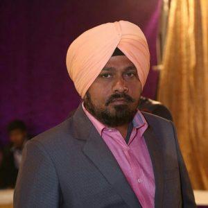Dr Dharmender Singh